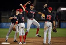 Jul 16, 2015; Toronto, Ontario, CAN; Canada center fielder Tyson Gillies (19) celebrates with teammates after defeating Puerto Rico during the 2015 Pan Am Games at Ajax Pan Am Ballpark. Mandatory Credit: Tom Szczerbowski-USA TODAY Sports