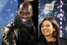 Paris Mayor Anne Hidalgo (R) and French actor Omar Sy (L) attend the ceremony to inaugurate the Christmas holiday lights on the Champs Elysees in Paris November 20, 2014. REUTERS/Charles Platiau