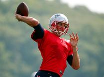 Jul 30, 2015; Foxborough, MA, USA; New England Patriots quarterback Tom Brady (12) throws during training camp at Gillette Stadium. Mandatory Credit: Winslow Townson-USA TODAY Sports