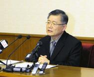 Hyeon Soo Lim speaks during a news conference at the People's Palace of Culture in Pyongyang, in this undated photo released by North Korea's Korean Central News Agency (KCNA) on July 30, 2015. REUTERS/KCNA