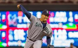 Jul 31, 2015; Minneapolis, MN, USA; Seattle Mariners starting pitcher Taijuan Walker (32) pitches in the seventh inning against the Minnesota Twins at Target Field. The Seattle Mariners beat the Minnesota Twins 6-1. Mandatory Credit: Brad Rempel-USA TODAY Sports