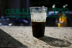 A coffee cup of a nitrogen-infused cold brew coffee from Brooklyn-based roaster Gillies Coffee out of a tap is seen at Guy & Gallard cafeteria in New York July 31, 2015. REUTERS/Eduardo Munoz