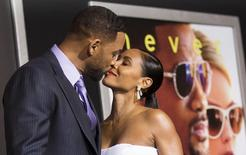 "Cast member Will Smith and his wife Jada Pinkett Smith kiss at the premiere of ""Focus"" at the TCL Chinese theatre in Hollywood, California February 24, 2015. REUTERS/Mario Anzuoni"
