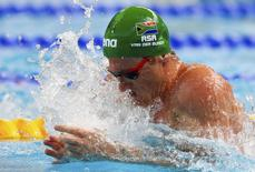 Cameron van der Burgh of South Africa swims to set a new world record in the men's 50m breaststroke preliminaries at the Aquatics World Championships in Kazan, Russia, August 4, 2015.  REUTERS/Hannibal Hanschke