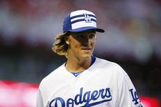 Jul 14, 2015; Cincinnati, OH, USA; National League pitcher Zack Greinke (21) of the Los Angeles Dodgers reacts after the second inning of the 2015 MLB All Star Game at Great American Ball Park. Rick Osentoski-USA TODAY Sports