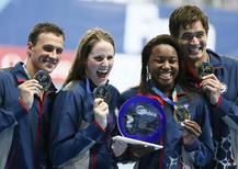 The relay team of the U.S., Ryan Lochte, Missy Franklin, Simone Manuel and Nathan Adrian (L-R) pose with their gold medals after winning the mixed 4x100m freestyle relay final at the Aquatics World Championships in Kazan, Russia, August 8, 2015.              REUTERS/Stefan Wermuth