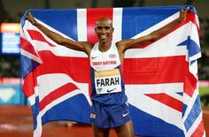 Athletics - IAAF Diamond League 2015 - Sainsbury's Anniversary Games - Queen Elizabeth Olympic Park, London, England - 24/7/15 Great Britain's Mo Farah celebrates after winning the Men's 3000m Action Images via Reuters / Matthew Childs