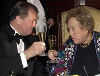 Jacques Pepin (L) toasts  Chef Julia Child  in Boston, Massachusetts November 19, 2000. Reuters photographer