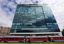 """General view of the Pacific Rubiales building as the """"La Sabana"""" tourist train is pictured in the foreground in Bogota March 8, 2015. REUTERS/Jose Miguel Gomez"""