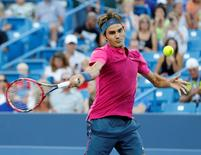 Aug 18, 2015; Cincinnati, OH, USA; Roger Federer (SUI) returns a shot against Roberto Bautista Agut (not pictured) on day four during the Western and Southern Open tennis tournament at Linder Family Tennis Center. Aaron Doster-USA TODAY Sports