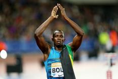 Athletics - IAAF Diamond League 2015 - Sainsbury's Anniversary Games - Queen Elizabeth Olympic Park, London, England - 24/7/15 Jamaica's Usain Bolt celebrates after winning the Men's 100m Final Action Images via Reuters / Matthew Childs