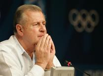 Former disciplinary spokesman for the International Olympic Committee Francois Carrard pauses during a news conference in Athens in this file photo taken on August 16, 2004.