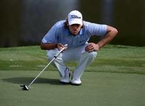 Andrew Loupe reads the green on the 15th hole during the first round of the Wyndham Championship golf tournament at Sedgefield Country Club. Mandatory Credit: Rob Kinnan-USA TODAY Sports