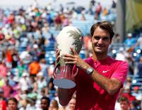 Aug 23, 2015; Cincinnati, OH, USA; Roger Federer (SUI) holds the Rookwood Cup after defeating Novak Djokovic (not pictured) in the finals during the Western and Southern Open tennis tournament at the Linder Family Tennis Center.  Aaron Doster-USA TODAY Sports