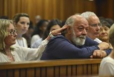 Barry Steenkamp, father of Reeva Steenkamp, is consoled by his wife June Steenkamp during the sentencing hearing of Olympic and Paralympic track star Oscar Pistorius at the North Gauteng High Court in Pretoria October 15, 2014.  REUTERS/Antoine de Ras/Pool