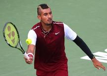 Aug 13, 2015; Montreal, Quebec, Canada; Nick Kyrgios of Australia hits a shot against John Isner of the United States (not pictured) during the Rogers Cup tennis tournament at Uniprix Stadium. Mandatory Credit: Jean-Yves Ahern-USA TODAY Sports