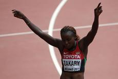 Joyce Zakary of Kenya gestures after her women's 400 metres heat at the 15th IAAF World Championships at the National Stadium in Beijing, China August 24, 2015.   REUTERS/David Gray