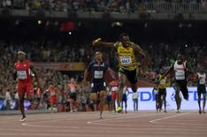 Aug 29, 2015; Beijing, China; Usain Bolt runs the anchor leg on the Jamaica 4 x 100m relay that won in 37.36 during the IAAF World Championships in Athletics at National Stadium. From left: Michael Rodgers (USA), Jimmy Vicaut (FRA), Botl and Justyn Warner (CAN). Mandatory Credit: Kirby Lee-USA TODAY Sports