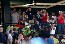 Aug 29, 2015; Atlanta, GA, USA; Spectators react as emergency personnel treat a person who fell from the upper deck in the seventh inning of the Atlanta Braves game against the New York Yankees at Turner Field. Jason Getz-USA TODAY Sports