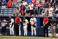 Aug 30, 2015; Atlanta, GA, USA; Atlanta Braves manager Fredi Gonzalez (33) and fans and coaches observe a moment of silence in memory of a fan that fell to his death during last night's game prior to the game between the Atlanta Braves and the  New York Yankees at Turner Field.  Dale Zanine-USA TODAY Sports