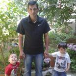 Abdullah Kurdi (C) poses with his sons Aylan (L) and Galip (R) in an undated photo provided by the Kurdi family.  REUTERS/Kurdi family/Handout via Reuters