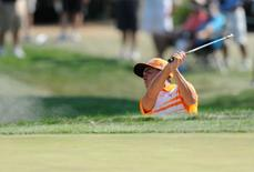 Sep 7, 2015; Norton, MA, USA; Rickie Fowler hits out of a bunker onto the 7th green to set up a birdie during the final round at the Deutsche Bank Championship at TPC of Boston. Mandatory Credit: Mark Konezny-USA TODAY Sports