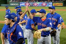 Sep 8, 2015; Washington, DC, USA; New York Mets third baseman David Wright (5) and his teammates celebrate on the field after defeating the Washington Nationals 8-7 at Nationals Park.  Mandatory Credit: Tommy Gilligan-USA TODAY Sports