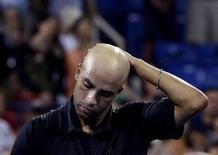 James Blake of the U.S. reacts after losing to Ivo Karlovic of Croatia at the U.S. Open tennis championships in New York August 28, 2013. REUTERS/Shannon Stapleton