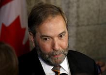 NDP leader Tom Mulcair talks to reporters after the federal budget was delivered on Parliament Hill in Ottawa April 21, 2015. REUTERS/Patrick Doyle