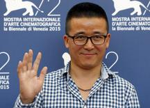 "Director Zhao Liang attends the photocall for the movie ""Bei Xi Mo Shuo"" (Behemoth) at the 72nd Venice Film Festival, northern Italy September 11, 2015. REUTERS/Stefano Rellandini"