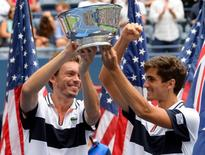 Sep 12, 2015; New York, NY, USA;  Pierre-Hugues Herbert (right) and Nicolas Mahut of France with the US Open Trophy after beating Jamie Murray of the United Kingdom and John Peers of Australia in the Men's Doubles Final on day thirteen of the 2015 U.S. Open tennis tournament at USTA Billie Jean King National Tennis Center. Robert Deutsch-USA TODAY Sports
