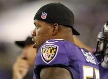 Baltimore Ravens linebacker Terrell Suggs (55) watches from the sideline during the first half of their NFL pre-season football game against the Atlanta Falcons in Baltimore, Maryland, August 15, 2013. REUTERS/Jonathan Ernst