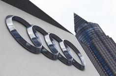 A logo of German carmaker Audi is pictured next to the Messeturm, Frankfurt's fair tower, during the media day at the Frankfurt Motor Show (IAA) in Frankfurt, Germany, September 14, 2015. REUTERS/Ralph Orlowski