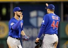 Chicago Cubs third baseman Kris Bryant (L) and first baseman Anthony Rizzo (44) celebrate after defeating the Pittsburgh Pirates in twelve innings at PNC Park.  Charles LeClaire-USA TODAY Sports