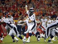 Denver Broncos quarterback Peyton Manning (18) throws a pass against the Kansas City Chiefs in the first  half at Arrowhead Stadium. Denver won the game 31-24.  John Rieger-USA TODAY Sports