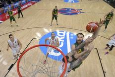 Lithuania's Antanas Kavaliauskas (R) goes up for a basket over Serbia's Miroslav Raduljica during their EuroBasket 2015 semi-final game at the Pierre Mauroy stadium in Villeneuve d'Ascq, near Lille, France, September 18, 2015. REUTERS/Emmanuel Dunand/Pool