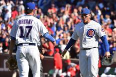Sep 19, 2015; Chicago, IL, USA; Chicago Cubs third baseman Kris Bryant (17) and first baseman Anthony Rizzo (44) celebrate defeating the St. Louis Cardinals 5-4 at Wrigley Field. Mandatory Credit: Jasen Vinlove-USA TODAY Sports