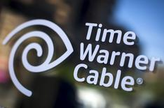 A Time Warner Cable sign and logo are seen on a Time Warner Cable store in the Manhattan borough of New York City, May 26, 2015.  REUTERS/Mike Segar