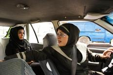 A female taxi driver is seen fetching a passenger in Tehran August 21, 2011.REUTERS/Raheb Homavandi