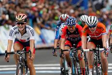 Sep 26, 2015; Richmond, VA, USA; Elizabeth Armistead of Great Britain (L) reacts after beating Anna Van Der Breggen of the Netherlands (R) and Megan Guarnier of the United  States (M) to the finish line to win the women's elite road race in the UCI road world championships 2015 at the Richmond Road Circuit. Mandatory Credit: Geoff Burke-USA TODAY Sports