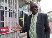 Trinidad and Tobago's former National Security Minister and former FIFA Vice President, Jack Warner, gestures after leaving the offices of the Sunshine Newspaper which he owns, in Arouca, East Trinidad, in this file photo taken May 27, 2015.  Warner, once one of the most powerful men in world soccer, has been banned from all football-related activities for life, the ethics committee of the global governing body FIFA said on Tuesday.  REUTERS/Andrea De Silva/Files