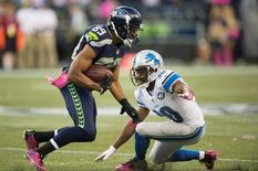 Oct 5, 2015; Seattle, WA, USA; Seattle Seahawks wide receiver Doug Baldwin (89) breaks away from Detroit Lions cornerback Josh Wilson (30) during the third quarter at CenturyLink Field. The Seahawks won 13-10. Mandatory Credit: Troy Wayrynen-USA TODAY Sports