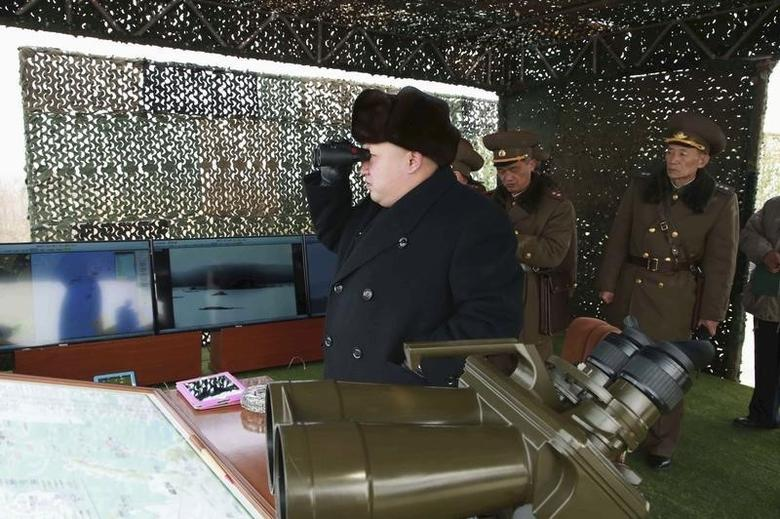 North Korean leader Kim Jong Un (L) guides artillery fire and landing exercises in this undated photo released by North Korea's Korean Central News Agency (KCNA) in Pyongyang February 21, 2015. REUTERS/KCNA/Files