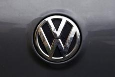 A Volkswagen logo is seen on one of the German automaker's cars in a street in Sydney, Australia, October 8, 2015.  REUTERS/David Gray