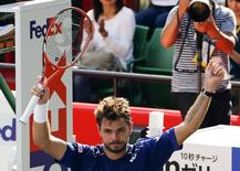 Switzerland's Stan Wawrinka reacts after defeating Austin Krajicek of the U.S. during their men's singles tennis match at the Japan Open championships in Tokyo October 9, 2015.   REUTERS/Thomas Peter