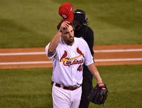 Oct 9, 2015; St. Louis, MO, USA; St. Louis Cardinals starting pitcher John Lackey (41) waves to fans after being pulled in the eighth inning of game one of the NLDS against the Chicago Cubs at Busch Stadium. Mandatory Credit: Jasen Vinlove-USA TODAY Sports