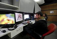 Prime Focus employees work inside a visual effects studio in Mumbai, India, October 8, 2015. REUTERS/Danish Siddiqui