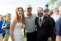 Stephanie Mirkin (L) and Brian Tobe (R) are pictured with U.S. President Obama Obama during their wedding at The Lodge at Torrey Pines in La Jolla, California October 11, 2015. REUTERS/Jeff Youngren/Handout via Reuters