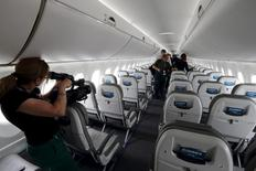 Journalists visit the cabin of the Bombardier CS100 aircraft after a news conference one day before the opening of the 51st Paris Air Show at Le Bourget airport near Paris June 14, 2015. REUTERS/Pascal Rossignol