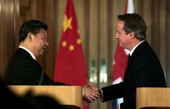 Le président chinois, Xi Jinping, a conclu mercredi à Londres une série d'accords pour 40 milliards de dollars, notamment dans le domaine du nucléaire, point d'orgue d'une visite d'Etat de quatre jours. /Photo prise le 21 octobre 2015/REUTERS/Suzanne Plunkett